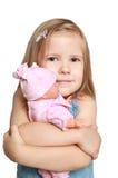 A menina com uma boneca favorita Fotos de Stock Royalty Free