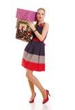 Menina com uma caixa de presente em um fundo branco foto de stock royalty free