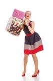 Menina com uma caixa de presente em um fundo branco imagem de stock