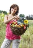Menina com uma cesta Imagem de Stock Royalty Free