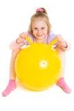 Menina com uma esfera Imagens de Stock