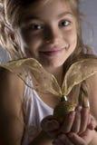 Menina com uma esfera do Natal Fotos de Stock Royalty Free