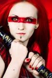 Menina com uma espada japonesa a Fotos de Stock