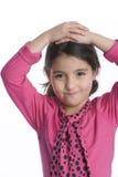 Menina com uma expressão tímida Fotografia de Stock