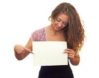 Menina com uma folha branca Foto de Stock