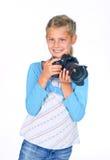 Menina com uma lente grande da câmera. imagem de stock royalty free