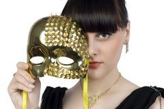 Menina com uma máscara Fotografia de Stock Royalty Free