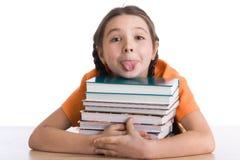 Menina com uma pilha dos livros Foto de Stock Royalty Free