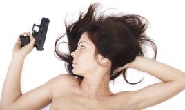 A menina com uma pistola Foto de Stock