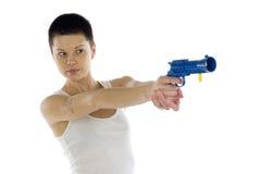 Menina com uma pistola do brinquedo Imagem de Stock