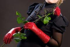 A menina com uma rosa Fotografia de Stock