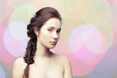 Menina com uma trança Fotos de Stock Royalty Free