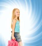 Menina com uma trouxa cor-de-rosa Fotografia de Stock Royalty Free