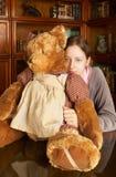 Menina com urso da peluche Imagens de Stock