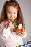 Menina com vegetais Foto de Stock Royalty Free