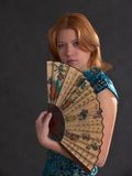 Menina com ventilador Foto de Stock