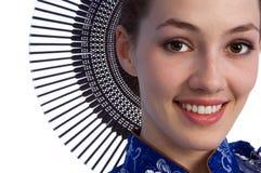 Menina com ventilador 2 Imagem de Stock Royalty Free