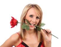 A menina com vermelho levantou-se Fotografia de Stock Royalty Free
