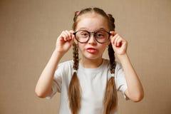 Menina com vidros grandes Fotos de Stock Royalty Free