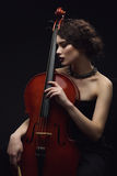 Menina com violoncelo Fotos de Stock