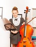 Menina com violoncelo, corda e notas musicais Fotografia de Stock