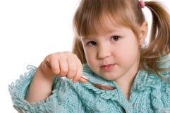 A menina come Imagens de Stock