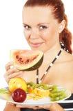 A menina come frutas Foto de Stock Royalty Free