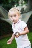 a menina come o donnut Imagens de Stock