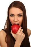 A menina come uma maçã imagem de stock royalty free