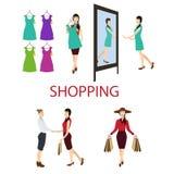 A menina compra um vestido na loja Fotografia de Stock