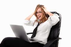 Menina confusa do negócio na cadeira Imagens de Stock