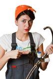 Menina confusa que tenta reparar a torneira Fotos de Stock Royalty Free