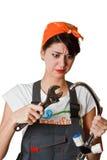 Menina confusa que tenta reparar a torneira Foto de Stock Royalty Free