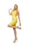 Menina consideravelmente justa no vestido amarelo isolado no branco Imagens de Stock