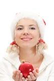 Menina consideravelmente loura no chapéu do ajudante de Santa Imagem de Stock