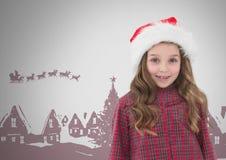 Menina contra o fundo cinzento com chapéu de Santa Christmas e ilustrações do Natal fotografia de stock