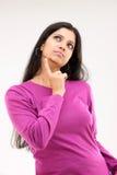 Menina cor-de-rosa do vestido na expressão pensativa Imagens de Stock Royalty Free
