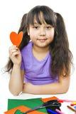 A menina corta o coração Foto de Stock Royalty Free