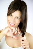 A menina corta seu sorriso longo do cabelo Foto de Stock