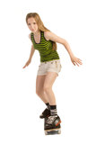 Menina cuidadosa no skate Fotos de Stock Royalty Free