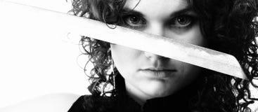 Menina curly e espada da mulher Curly Fotos de Stock Royalty Free