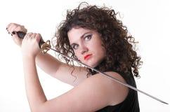 Menina curly e espada da mulher curly do retrato Imagens de Stock Royalty Free