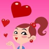 A menina dá os beijos, voando o coração vermelho Fotos de Stock Royalty Free