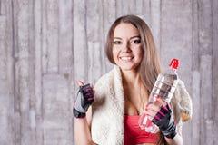 Menina da aptidão com o frasco da água Imagens de Stock
