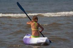 Menina da canoa Fotos de Stock