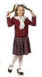 A menina da cereja em uma farda da escola Foto de Stock Royalty Free