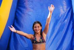 Menina da corrediça de água Foto de Stock