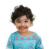 Menina da criança com a boca manchada com o chocolate Fotos de Stock
