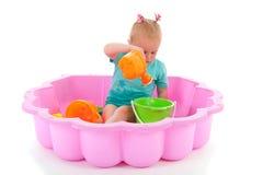 Menina da criança na piscina Imagem de Stock Royalty Free