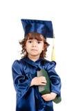Menina da criança na roupa do academician com livro imagens de stock